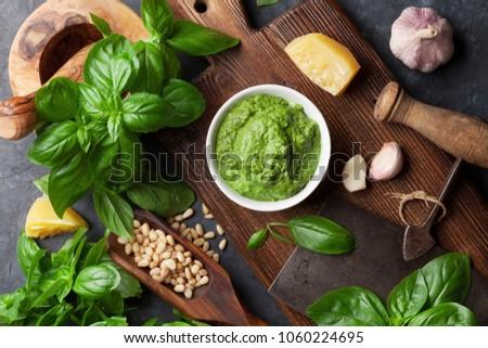 Pesto sauce cooking. Basil, olive oil, parmesan, garlic, pine nuts. Top view on dark stone table #1060224695