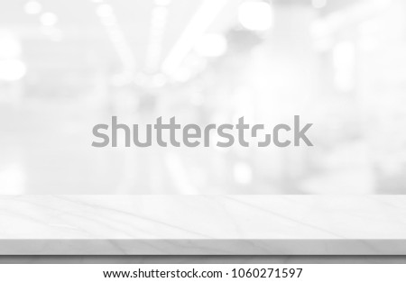 Empty white marble over blur background, for your photo montage or product display, Space for placing items on the table, product and food display. #1060271597