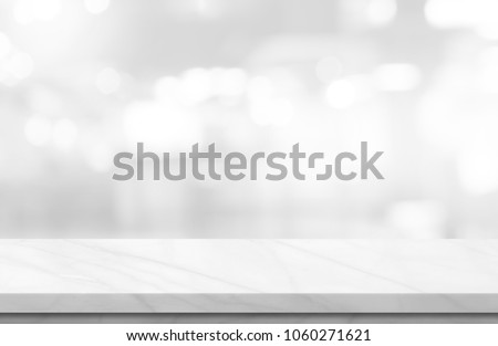 Empty white marble over blur background, for your photo montage or product display, Space for placing items on the table, product and food display. #1060271621