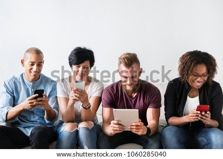 Group of diverse people using digital devices #1060285040