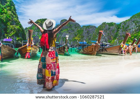 Traveler Asian woman in summer dress joy relaxing on sunny beach Maya bay Phi Phi island Krabi Travel Thailand fun beach, Tourism beautiful destination place Asia, Girl on summer holiday vacation trip #1060287521