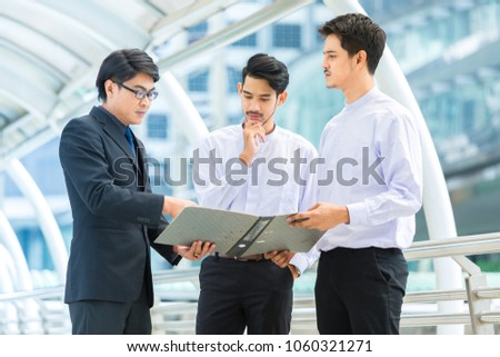 three male workers standing and discussion about work outside office,teamwork , workgroup concept #1060321271