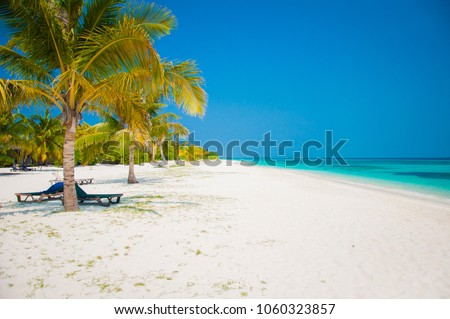 Beautiful white send beach tropical island blue lagoon. Perfect vacation relax sea view on Maldive #1060323857
