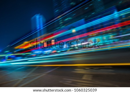 the light trails on the modern building background #1060325039