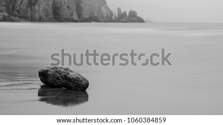 A misty day at Lunan Bay Beach #1060384859