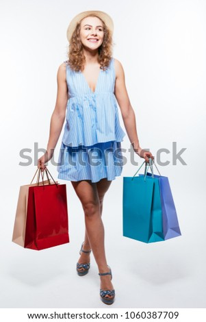 Colourful shopping vibes. Full length portraits of cheerful woman in hat and bright clothes with shopping bags #1060387709