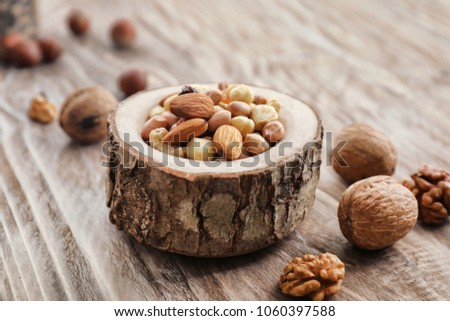 Mix of nuts on wooden background #1060397588