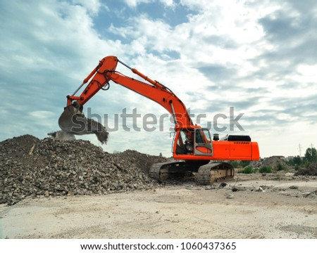 Crawler excavator on construction site. Isolated big crawler excavator working on construction site. Royalty-Free Stock Photo #1060437365