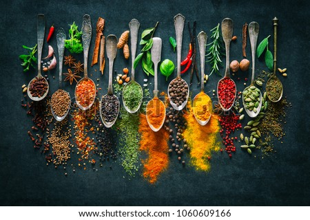 Colourful various herbs and spices for cooking on dark background  #1060609166