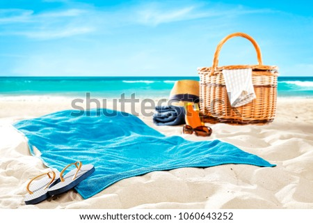 Towel on beach and free space for your decoration.  #1060643252