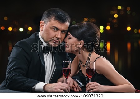 woman and man with wine glasses on night background #106071320