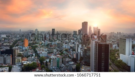 Panoramic View of Mexico City - Mexico. Reforma Paseo Mexico landmark at sunset time/ Royalty-Free Stock Photo #1060717751