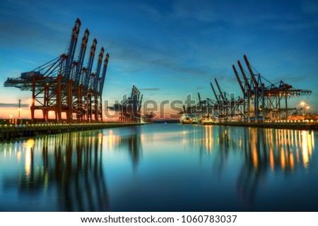 Container terminal Burchardkai in the port of Hamburg during blue hour Royalty-Free Stock Photo #1060783037