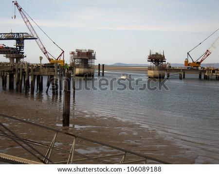 Construction of bridge over Ross River, Townsville, Queensland Australia #106089188