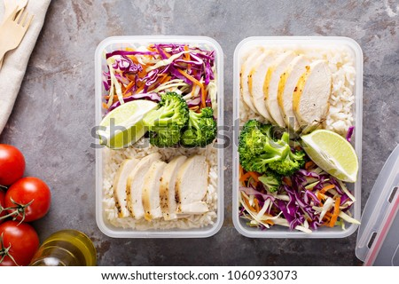 Healthy meal prep containers with chicken, rice and cole slaw salad #1060933073