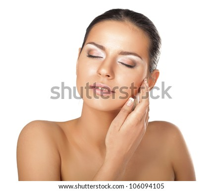 Portrait of young woman with healthy skin touching her face isolated #106094105