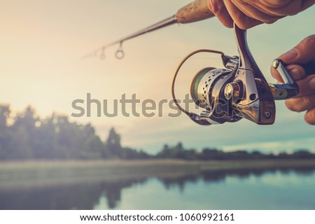 Fishing on the lake at sunset. Fishing background. #1060992161