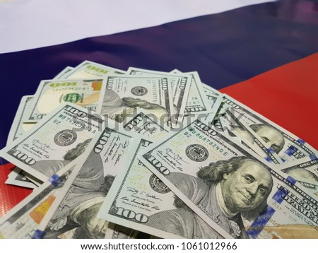 Dollar falls on the Russian flag and cyber security concept #1061012966
