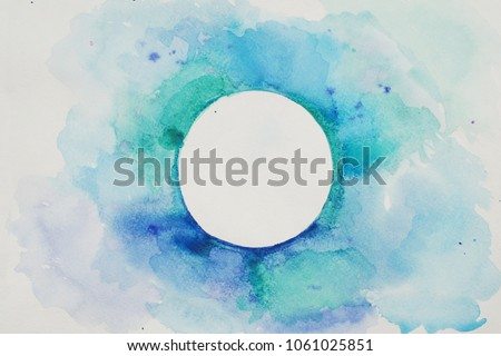 Watercolor Stylized Circle in Blue Colors on a White Textured Background. Watercolor. #1061025851