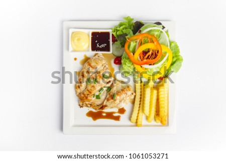 Japanese style, Grilled chicken breast steak with salad vegetable, french fries, and on white background #1061053271