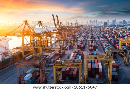 Logistics and transportation of Container Cargo ship and Cargo plane with working crane bridge in shipyard at sunrise, logistic import export and transport industry background #1061175047