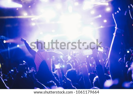 Portrait of happy crowd enjoying at music festival #1061179664