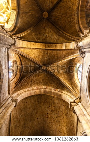 Benavente, Zamora, Castilla y Leon, Spain; 11-25-2017: Interior view of cross vault, pointed arches and pillars, show some of different architectural styles found in Church of Santa Maria del Azogue #1061262863