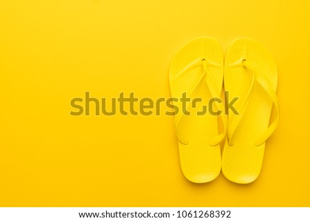 beach flip-flops on the yellow background with copy space. summer is concept #1061268392