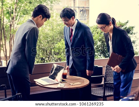 Business people greeting bowing gesture Royalty-Free Stock Photo #1061269235