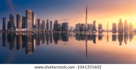 Mystical panoramic view of Dubai Business bay with purple sunrise, UAE #1061355602
