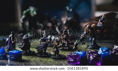 Role play board game with miniatures with dragon in dungeons.