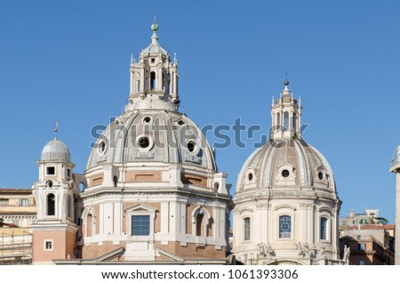 ROME, ITALY, APRIL 29, 2017: The domes of Church of the Most Holy Name of Mary adjacent to the famous Trajan's Column can be seen set against blue skies #1061393306