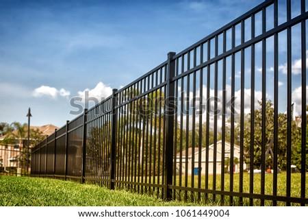 Black Aluminum Fence  Royalty-Free Stock Photo #1061449004