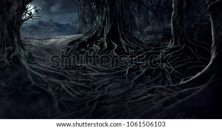 creepy trees with twisted roots in the night jungle forest. Scary concept.
