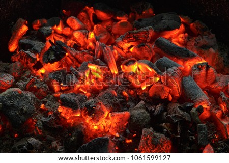 actively smoldering embers of fire #1061599127