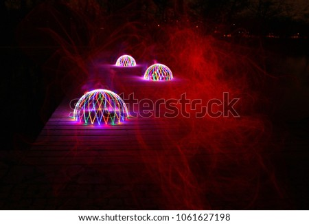 Mystical glowing domes with red mist #1061627198