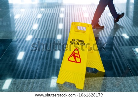 """""""Caution wet floor"""" sign Royalty-Free Stock Photo #1061628179"""