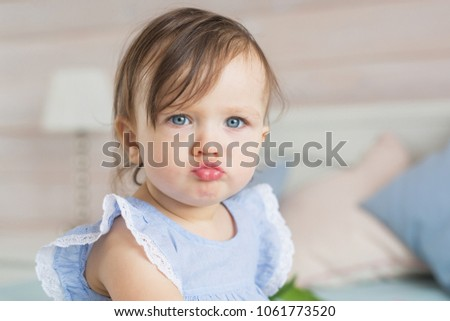 Pretty little baby girl is angry #1061773520