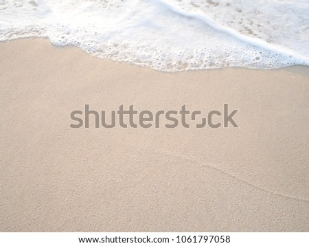 Soft wave of the tropical sea on the sandy beach. #1061797058