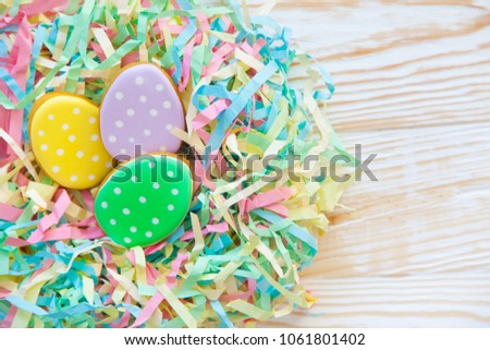 Sweets for celebrate Easter. Gingerbread in shape of easter bunny and easter eggs. White and color background top view copy space #1061801402