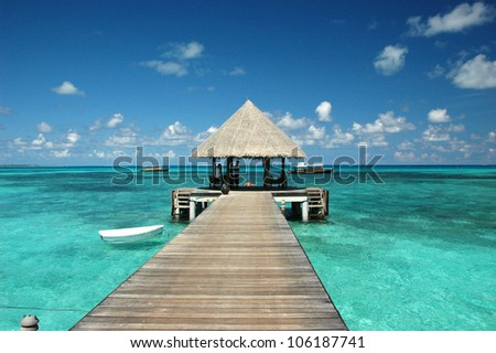 Wooden wharf with pavilion for ships at Maldives #106187741