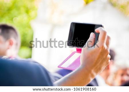 Hands using a smart phone in outdoor #1061908160