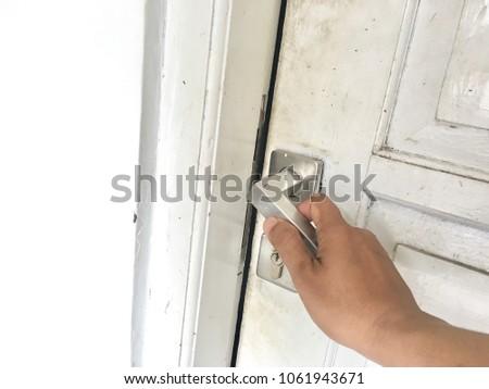 Hand Open door. a hand on handle with white door #1061943671