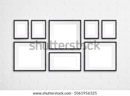Black wooden photo frames mockup, eight set collection on white bricks wall, interior decor