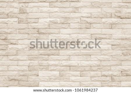 Cream and white brick wall texture background. Brickwork or stonework flooring interior rock old pattern clean concrete grid uneven bricks design stack. #1061984237