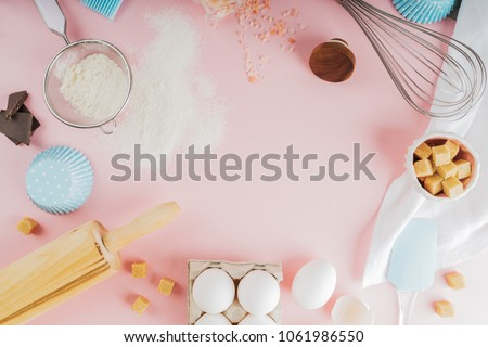 Frame of food ingredients for baking on a gently pink pastel background. Cooking flat lay with copy space. Top view. Baking concept. Mockup. #1061986550