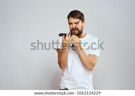 man looks at joystick, logo                              #1062124229