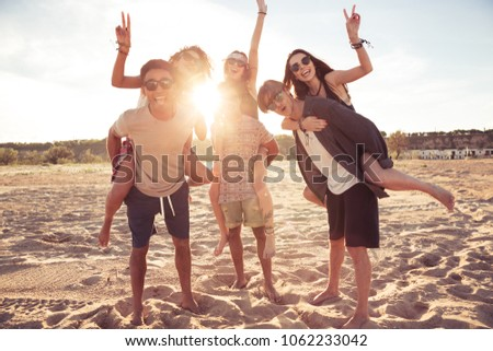 Image of happy cheerful young loving couples friends walking outdoors on the beach having fun. #1062233042