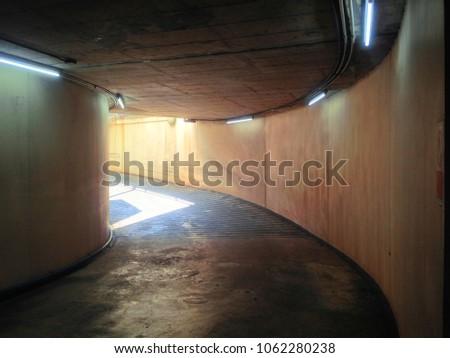 Exit parking basement at parking lot. #1062280238