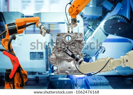 Industrial robotic welding, robot gripping and robotic 3D scan working with auto parts on smart factory, on machine blue tone color background, industry 4.0 and technology, concept and idea Royalty-Free Stock Photo #1062476168